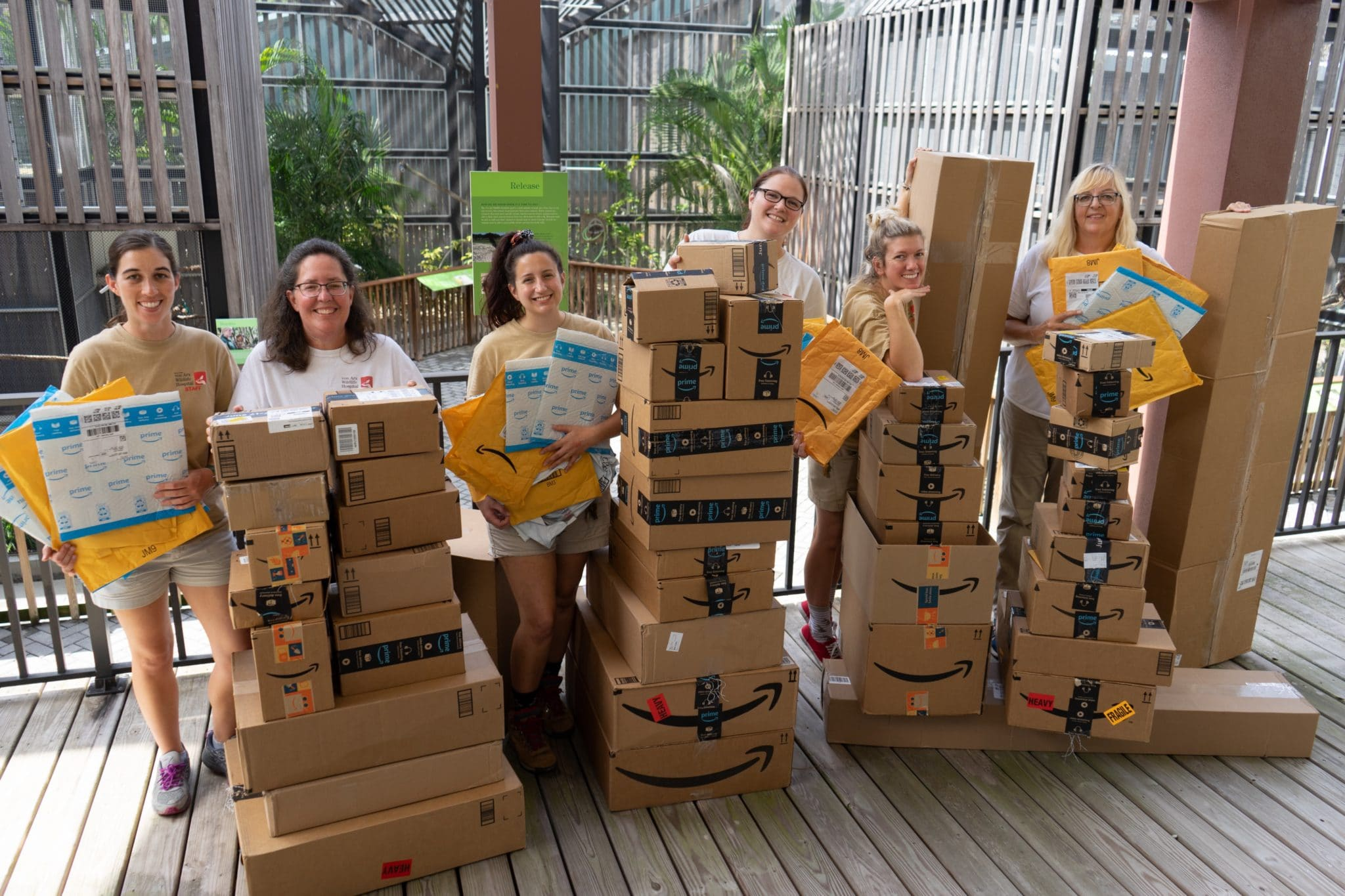 Wildlife staff in front of packages sent in from Amazon Wish LIst